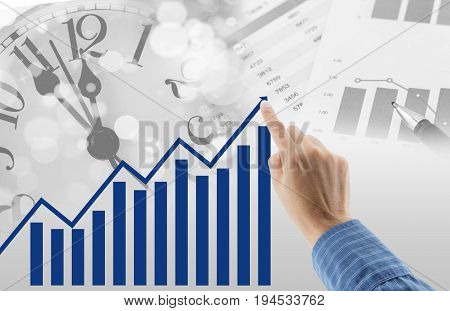 Man Drawing Graph Growth Of Business Duration With Time Clock And Document Background