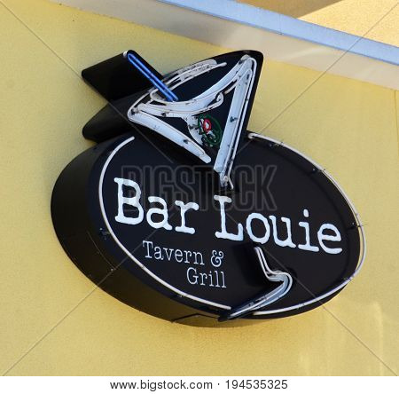 PERRYSBURG OH - JUN 25: A sign for Bar Louie in Perrysburg OH is shown here on June 25 2017. There are more than 110 locations in the United States.