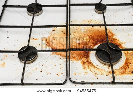Very dirty filled with fat gas stove at the kitchen