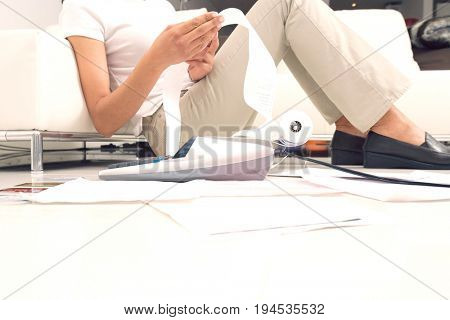 Low section of an African American woman calculating her domestic expenses at home