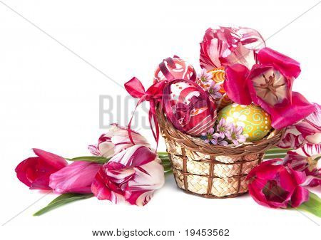 Basket full of Easter eggs and flower tulips