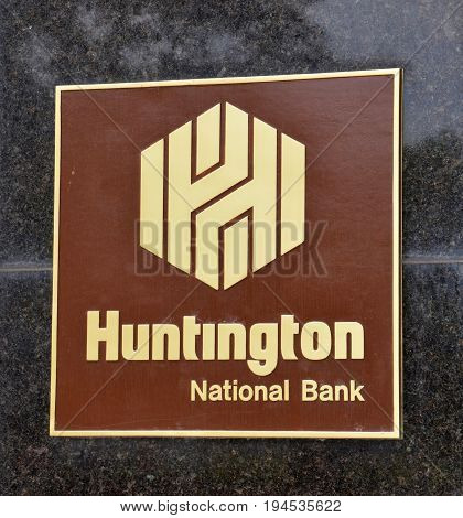 COLUMBUS OH - JUN 28: A sign for the Huntingon Bank in downton Columbus OH is shown here on June 28 2017. They are headquartered in Columbus.