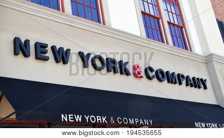 PERRYSBURG OH - JUN 25: The logo of the New York & Company store in Perrysburg OH is shown here on June 25 2017.