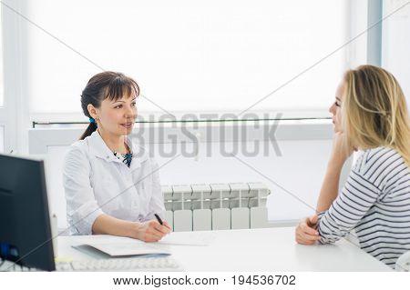 Horizontal view of happy patient at doctor's office.