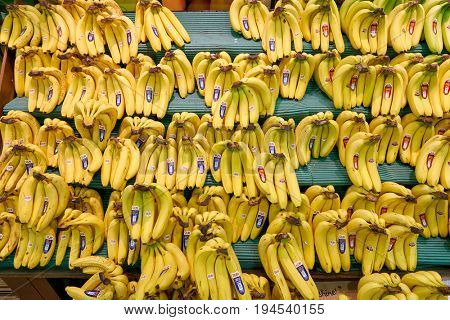 SEOUL, SOUTH KOREA - CIRCA MAY, 2017: bananas on display at Lotte Mart in Seoul. Lotte Mart is an east Asian hypermarket that sells a variety of groceries, clothing, toys, electronics, and other goods