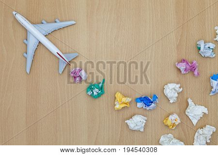 airplane model on wooden background Travel and tour concept.