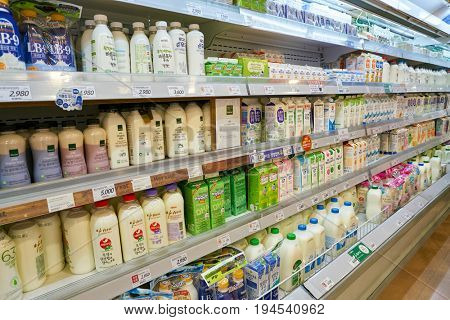 SEOUL, SOUTH KOREA - CIRCA MAY, 2017: milk on display at Lotte Mart in Seoul. Lotte Mart is an east Asian hypermarket that sells a variety of groceries, clothing, toys, electronics, and other goods.