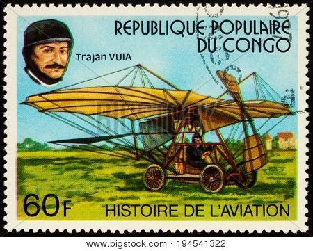 Moscow Russia - July 09 2017: A stamp printed in Congo shows Romanian inventor and aviation pioneer Trajan Vuia and his aircraft series