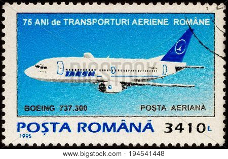 Moscow Russia - July 07 2017: A stamp printed in Romania shows passenger airliner Boeing 737.300 series