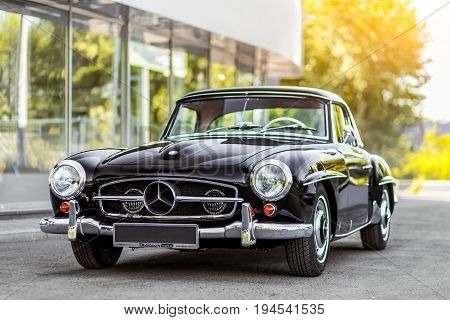 Novosibirsk Russia - June 16 2017: Mercedes-Benz 190 sl side view. Photography of a classic car on a street in Novosibirsk