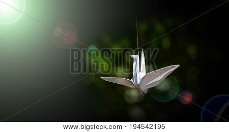 business vision concept with paper birds on green bokeh background and lighting flare