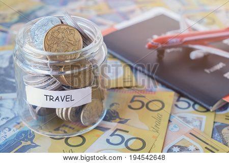 Australian money in TRAVEL jar with passport