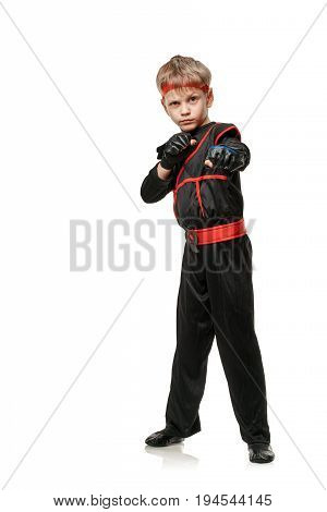 Young martial arts fighter practicing combat sport. Cosplay hero ninja poster