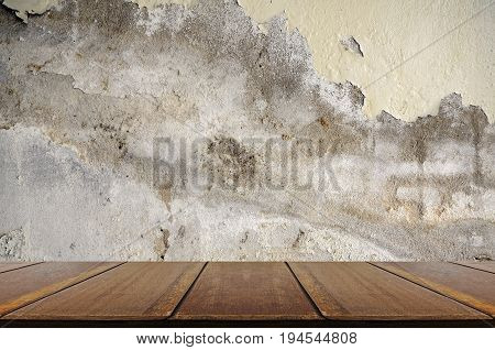 Perspective wood with grungy concrete wall. Old and deteriorate concrete wall. Grungy texture background.