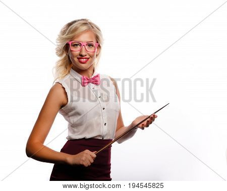 The teacher holds a pointer. The girl is dressed in a blouse a bow tie and glasses. Training. Positive look into the future. Back to school. Open smile.