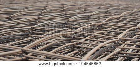 Stack of the metal reinforcement bars mesh for construction ; selective focus