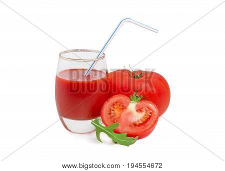 Tomato juice in glass with bendable drinking straw one whole and one half of the fresh ripe tomatoes and arugula leaf on a light background
