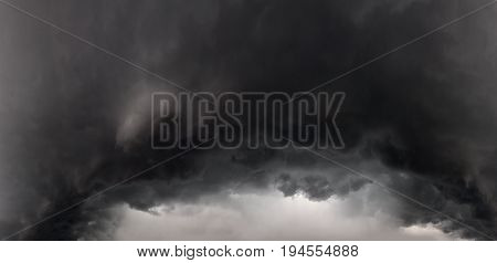 abstract background from sky and dark storm clouds panorama. panoramic landscape view of the stormy sky thunderstorm