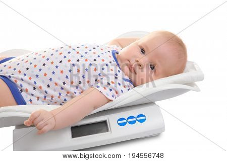 Scales with baby on white background