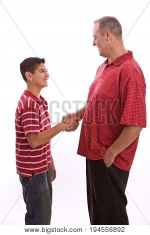 Happy Hispanic father and son isolated on white.