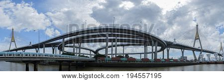 Panorama Bhumibol suspension bridge in Bangkok City Thailand also known as the Industrial Ring Road Bridge A landmark bridge over Chao Phraya River with reflections on the water