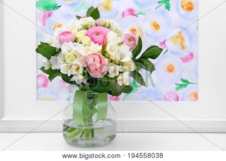 Beautiful bouquet with white freesia on table