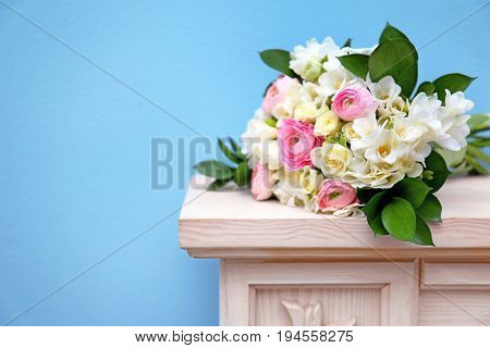 Beautiful bouquet with white freesia on mantelpiece