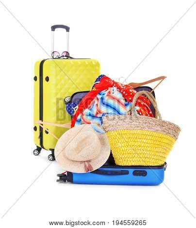 Pile of different heavy luggage on white background. Overweight concept