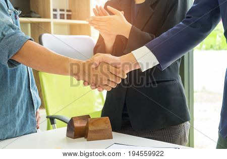 Concept home purchase contract, Home sales with customers hand in hand after the deal, Business people join hands with customers after the deal.