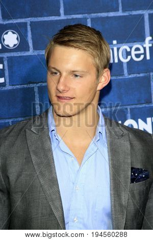 LOS ANGELES - FEB 23:  Alexander Ludwig at the Pre-Oscar charity brunch by Montblanc & UNICEF at Hotel Bel-Air on February 23, 2013 in Los Angeles, CA