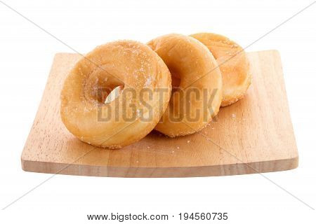 Sugary Donut On A Wooden Plate Isolated On A White Background