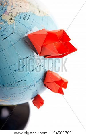 Traveling concept ship from a paper on the geographical map background clipping path