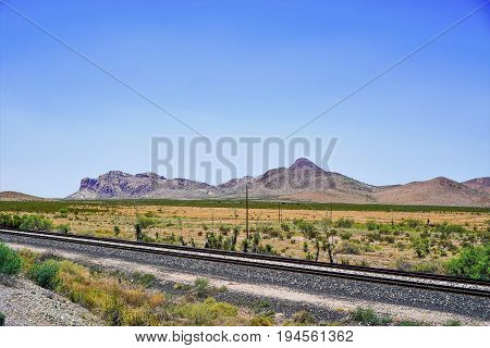 The railroad that connects east to west plus a beautiful set of mountains in the distance.