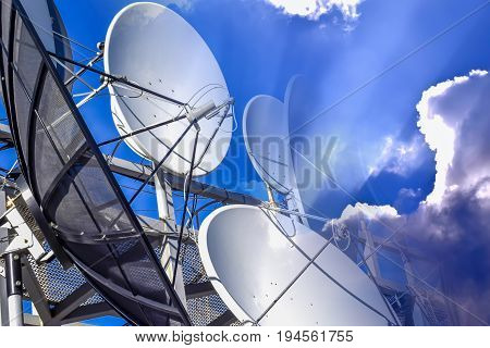 Satellite dish on blue sky background  antenna, satellite, dish, broadcasting, communication, parabola, transmission, reception,