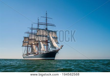 Clear sky, sunny afternoon , Four-masted barque three-quarters view