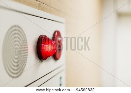 emergency light wall panel and alarm speaker sound in the office building.