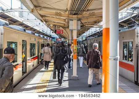 Osaka Japan - November 11 2015 :Japanese people transit interchange local line from Train to Train in Kobe Line for Sannomiya & Himeji station.