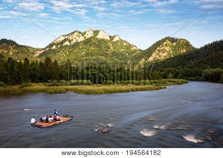 Rafting on the polish river on a Three Crowns background