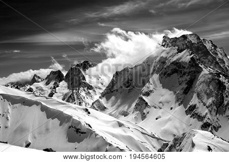 Black And White Winter Mountains With Snow Cornice And Cloudy Sky In Nice Sun Day