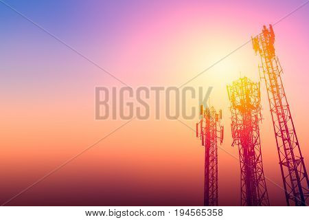communication tower or 3G network telephone cellsite with dusk sky with space for text