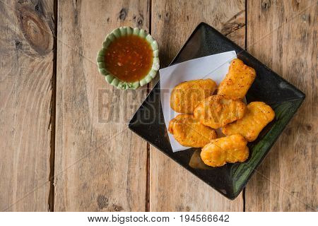 Chicken Nugget With Spicy Sauce Food Appetizer Ready To Eat On Wood Table.