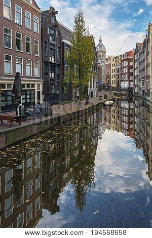 Amsterdam, Netherlands - October 30 2016: The canal houses along the junction of the canal Oudezijds Achterburgwal in the old center of Amsterdam