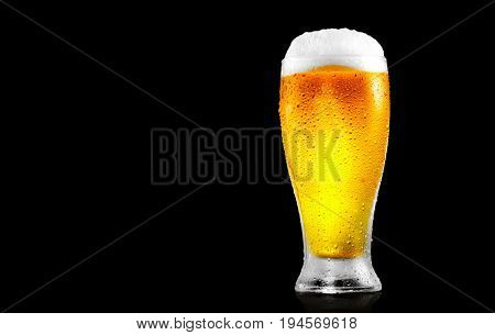 Beer. Cold Craft light Beer in a glass with water drops. Craft Beer close up isolated on black background