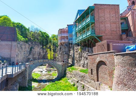 Tbilisi, Georgia - April 24, 2017: Sulphur baths, bridge and traditional houses in Old Town of Tbilisi