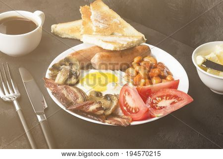 Traditional English Breakfast - Bacon, Sausages, Fried Eggs, Tomatoes, Beans, Mushrooms, Toast With