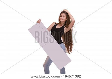 Smyling young woman with long hair posing with big nameplate or blank isolated on white background