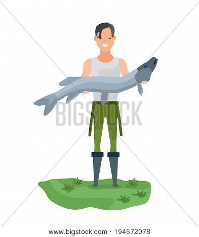 Young fisherman standing on the shore, holding a huge fish in his hands and showing off a catch. Vector illustration isolated in cartoon style.