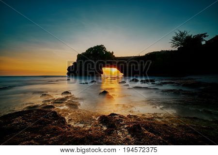 Beautiful Sunset Inside Rock Hole And Scenic Seascape At Tanah Lot Temple Indonesia