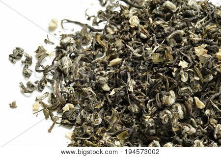 Green tea with jasmine on white background. Top view. Close up. High resolution