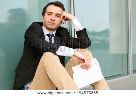 Fired Businessman Reading The Notice Of Job Termination